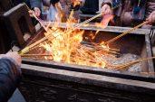 Burning Incense Sticks for Prayer