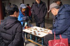 Old Men Playing Chinese Chess