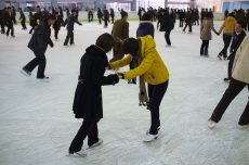 Friends Helping Each Other at Pyongyang Ice Rink