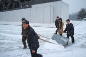 Locals Clearing Snow at Mansudae